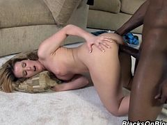 This horny blonde decides to striptease a black guy to get his dick horny and ready for wet blowjob before stuffing it inside her incredibly tight twat.