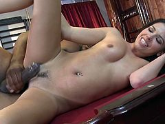 Long-haired brunette Danica Dillon is having a good time with a tattooed black stud indoors. They lick each other's privates and then fuck in missionary position and have doggy style anal sex.