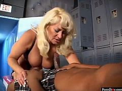 This gorgeous woman radiats confidence in her own power of seduction. She wants to fuck this black guy and this lucky dude isn't leaving any time soom. She gives him a nice blowjob in the locker room. Then she spreads her legs wide to let him fuck her tight twat in missionary position.