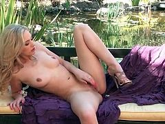 Blonde Sophia Knight masturbates pussy outdoors