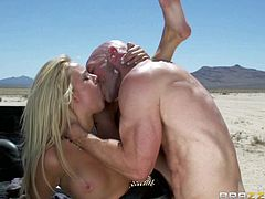 Passionate blonde Alexis Monroe withs sexy natural tits sucks cock and gets her asshole dicked in the back of a pick-up truck somewhere in the desert. She gets her ass drilled hard right in the sun!