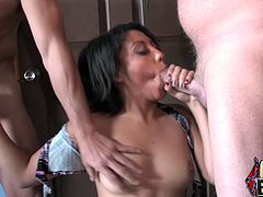 Get wild watching this ebony babe, with natural breasts and a shaved kitty, while she sucks and lick this guy's poles like a dirty slut!