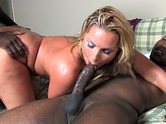 Click to watch this blonde MILF, with big boobs wearing a thong, while she goes hardcore doing a threesome over a nice bed. She is on fire!