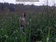 Crazy girl walks outdoors and starts to tickle her pussy