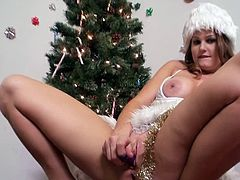 Get a load of this hardcore scene where the sexy Allison Moore gives you something to jerk off to as she masturbates next to the Christmas tree.