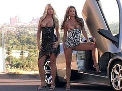 Have fun watching these blonde babes, with huge breasts wearing fancy dresses, while they take pictures half naked next to a exotic car.
