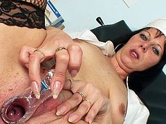 Sexy brunette nurse loves posing while fingering deep in her wet pussy