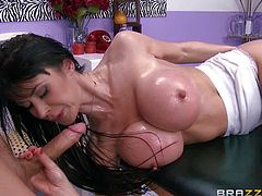 Eva Karera with massive fake tits is topless on massage table. She makes no secret of her juggs. Her revealing white panties cant hide her pussy. She gets hot and takes masseurs cock willingly!