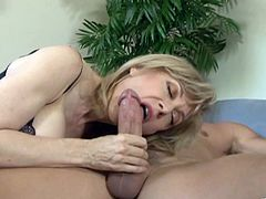 Nina Hartley is a hot mature blonde having her wet pussy drilled by this stud's big cock as she wears sensual lingerie.