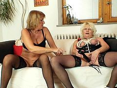 Enjoy two horny moms stroking their wet cunts in full lesbian action