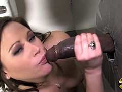 Have a blast watching this sweet brunette, with big boobs and a nice ass, while she has interracial sex with a dick form a gloryhole.