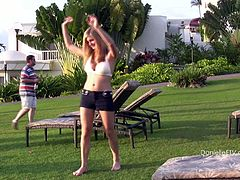 Witness this solo model video where a sexy blonde, wearing a bikini and shorts, while she acts naughty in a swimming pool. She is a kinky doll!