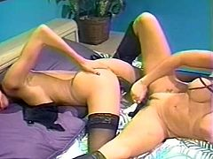 Sandy haired slutty bitch spreads her legs and gets her stinky pussy passionately drilled with huge fuck toy, which her kinky raven haired kooky recently acquired. Look at this zealous chicks in The Classic Porn sex clip!