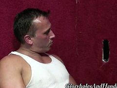 Glory Holes and Handjobs brings you a hell of a free interracial gay video where you can see how David Thompson sucks a hard black cock through the glory hole.