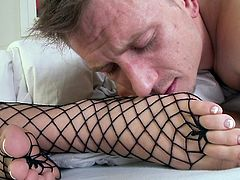 Using her feet to stimulate the guy is a truly impressive thing