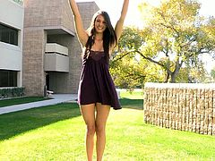 A beautiful babe takes off her sexy dress outdoors. Tiffany walks around the place and also touches her smooth pussy sitting on a tree.