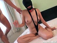 This gimp girl is used like a sexual slave by these two Japanese men. She is masked, so she can't see and all that she can do when her ball gag is taken out of her mouth, is to suck cock. She even squirt a dildo out of her butt, after is was shoved in there.