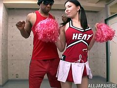 They may have lost the championship, but at least the Miami heat get to fuck one of the sexy Asian cheerleaders on the team. She does a dance to get their big black cocks hard and then sucks off the first one. She even works on the balls.