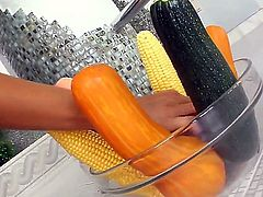 Provocative cheep looking whore Lara with natural tits and pierced clitoris in stripper shoes only stretches wet fish lips and stuffs ass with corn while her lover films everything.