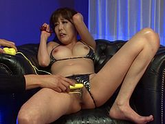 This Japanese slut is about to get naughty in the vip room of the club. She has her bikini top pulled aside to reveal her perfectly round bosom, and she gets a sex toy shoved in her pussy. She is so horny by the dildo insertion that she squirts her pussy juice all over the place. She licks her cum off from vibrator!