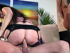 Perverted dark haired MILF and young and young kinky chick share one lucky guy's cock, sucking and jumping on it one at a time.