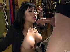 Venus Lux has her little slave girl tied up so she can have easy access to her cunt. Mia Li has to open up her mouth so Venus can stick her big dick inside there. She makes her give her head and then Venus pounds her tight pussy.