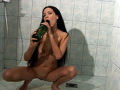 Having a stiff bottle gives her naughty ideas in masturbating her twat