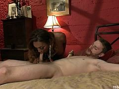 Tied on the bed's frame Sebastian awaits pleasure from his beautiful tranny Yasmin. She's tall, hot and has a big hard cock ready for Sebastian's mouth and perhaps ass. Look at her sucking his dick and then feeding him with her sweet cock. Are we going to see more naughty action from these two?