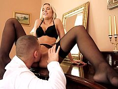 She admires herself in front of the mirror, when her guy approaches her from behind. The elegant blonde Dido deserves a hard fuck and this guy is about to give her one. He starts out by eating her pussy, making it nice and wet, ready for his dick. Then the blonde sucks his cock and receives it all in her snatch.