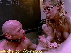 This blonde mistress ties up her teacher, humiliates him  by getting fucked by a real man with a huge dick and spits on him while she gets fucked by a colleague of hers.