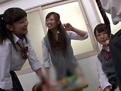 Hot kinky schoolgirls were in the classroom playing with their cunts when this guy was stalking them. We watched the cuties behind the door but the girls caught him and now they are taking advantage of his body. The young, cute sluts get wild with him and begin sucking his cock