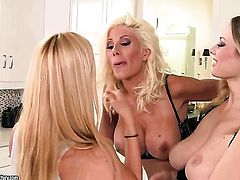 Blonde Puma Swede with huge jugs getting her dripping wet muff pie eaten out by lesbian Anita Dark