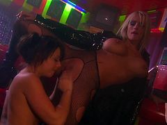Horny bitches Penny Flame and Stormy Daniels are having lesbian fun in a bar. They finger each other's cunts ardently and then fuck them with some long sticks.