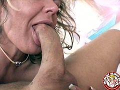 Perverted blonde haired cougar moans and seems to be enjoying sucking her partner's huge cock and licking his sweaty balls.