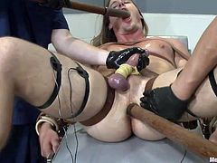 Kip is hard to please! He's a beautiful blonde male with long hair, hot abs and a big dick that needs some milking! The executors give their best to satisfy him and use their dildos to make it happen. As they fuck his mouth and tight anus one of the guys rub his tied penis. Kip is almost there and finally he cums