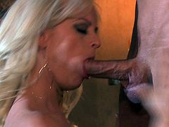 Get a boner watching this blonde pornstar, with big fake boobs and a great backyard, while she sucks a big cock and gets fucked hard.