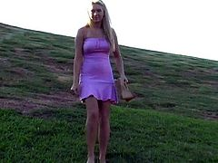 Entertain yourself by watching this long haired blonde, with giant breasts wearing a pink miniskirt, while she touches herself outdoors.