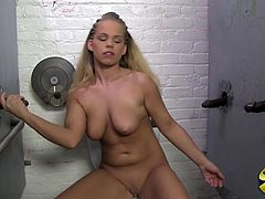 Have a blast watching this blonde babe, with big tits wearing shorts, while she has interracial sex with three black guys in a gloryhole.