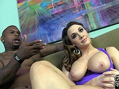 As they get ready for their shoot this couple hangs out backstage and she shows off her amazing, big tits during their interview.