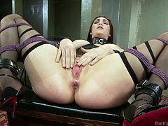 This kinky little sex slave has her pussy ready to take her executor's big cock. The master's helper takes a whip and slaps her pubis area to arouse her and then the cruel executor sticks his cock in the slave's tight vagina.