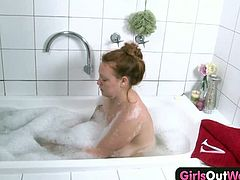 Red haired amateur plumper Lidia takes a bath and fingers her hairy pussy. Her big juggs are ready to bounce and she knows how to satisfy her pussy and climax.