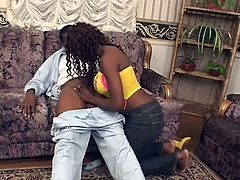 This lucky black guy is in for a treat because he's about to get jacked off by this sexy and curvy ebony beauty. She shows off her round booty and then pulls down her man's pants so she can get at his thick cock and suck on it.