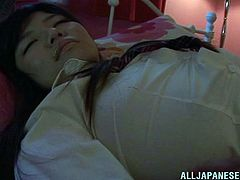 This cute Japanese schoolgirl has had a long day of school and studying. She is toss and turning in her slumber as if she can sense some is watching her. And someone is watching her!. A man comes in and opens up her blouse to see her tits and then rubs them and gropes those massive melons!