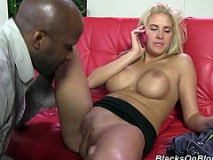 Make sure you see this! A blonde babe, with big fake boobs and a nice ass, while she goes hardcore with a big black cock in a reality clip.