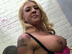 Sexy pornstar babe Leya is hanging out, relaxing with her big, fake tits out while waiting for her gloryhole shoot to begin.