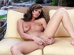 Daisy Lynn with gigantic breasts and smooth cunt exposes her neat wet hole in solo scene