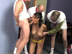 Entertain yourself by watching this ebony babe, with big knockers wearing a bikini, gets gangbanged by several man and moans loudly.