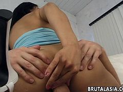 Mika Tan is a very sexy Asian milf who has a craving for cock in her mouth and in her pussy. She rides her man's cock on the couch like crazy. She tit fucks him and sucks on his cock and it goes through her boobs.