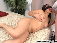 Kinky long-haired brunette milf is having fun with some man indoors. She favours him with a blowjob and then they bang in side-by-side and other positions.