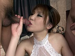 This brunette Asian has two cocks in her mouth at the same time and the dicks are so close they're almost touching. She sucks the hairy cocks good and even licks the ball sacks. When she can't continue to have both cock in her mouth at once she jerks one and sucks on the other. What a dirty slut she is.